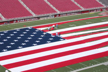 Huge American Flag Being Setup on Football Field